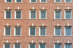 Free Red Brick Wall With Rows Of Windows Royalty Free Stock Photo - 61951855