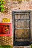 The Red brick wall and the wood closed door Stock Photo