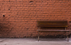 Red brick wall and bench Royalty Free Stock Photos