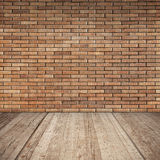 Red brick wall and wooden floor, empty interior Royalty Free Stock Photos