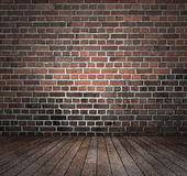 Red brick wall wooden floor Stock Photo