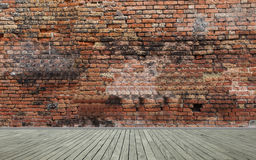 Red brick wall and wooden floor Stock Photography