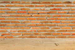 Red brick wall with wooden floor texture Stock Images