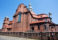 Red brick walls of the catholic church Stock Photo