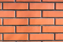 Red brick walls. A fence made of red bricks thin Royalty Free Stock Images