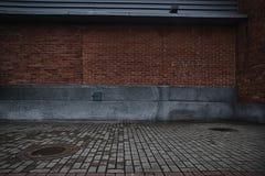 Red brick walls and rugged brick floor background. Abstract background of red brick walls and rugged brick floor. Outdoors Stock Photo