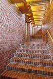 Red brick walls and staircase with wooden roof interior corridor. Red brick walls and staircase corridor. Architecture interior design Stock Image