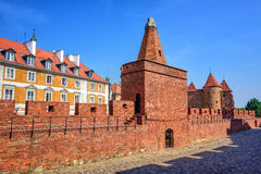 Red brick walls and towers of Warsaw Barbican, Poland royalty free stock photos