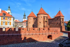 Red brick walls and towers of Warsaw Barbican, Poland Stock Photos