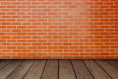 The red brick walls and wood floors. Stock Photography