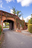 Red bricked building with open gate Royalty Free Stock Photography