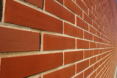 Red bricked wall in perspective Stock Image