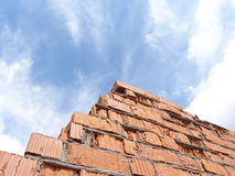 Red bricks. Red aged bricks and blue cloudy sky Stock Photo