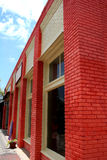 Red Bricks. Bright red brick wall on town shops Royalty Free Stock Photos