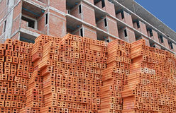 Red Bricks with being Constructed Building Background Stock Images