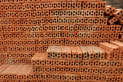 Red bricks for build in construction site. Royalty Free Stock Images