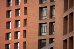 Red bricks building. Building made of red bricks full of windows. Different angles Royalty Free Stock Photography
