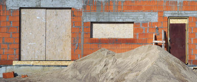 Red bricks  building on sand Stock Images