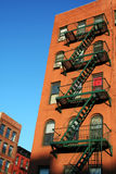 Red Bricks and Fire escape in New York. Fire escapes against red bricks in New York apartment building Stock Images
