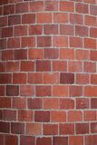 Red Bricks Form a Curved Smoke Stack. A chimney made of bricks and mortar royalty free stock photography