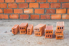 Red bricks in front of brick wall, focusing on the bricks in fro Stock Photography