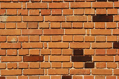 Red bricks house wall. Red bricks non-plastered house wall as background stock photo