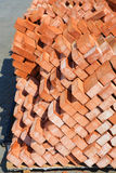 Red bricks laid in pallets Royalty Free Stock Photography