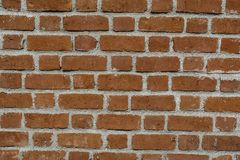 Red Bricks and Mortar - Typical Arrangement. Display of red bricks and mortar on a clean wall construction. Typical display of patterns involved in arranging stock image