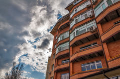 The red bricks of new house against blue sky with clouds.  Stock Image