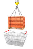 Red Bricks over wooden Pallet with Supermarket Shopping Basket Stock Photo
