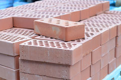 Red bricks on a pallet in the warehouse Royalty Free Stock Photos