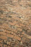 Red bricks pavement. Ancient red bricks pavement background royalty free stock photos