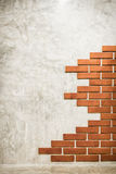 Red bricks on polished cement wall. Stock Photos