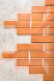 Red bricks on polished cement wall. Stock Photo