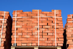 Red bricks stacked into cubes. Warehouse bricks. Storage brickworks products royalty free stock photography