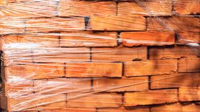 Red bricks . The bricks are stacked on wooden pallets and prepared for sale. Clay brick is an ecological building material royalty free stock photography