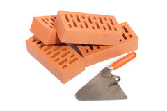 Red bricks and trowel Stock Images