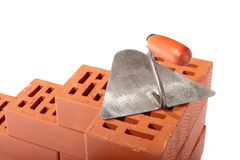 Red bricks and trowel Stock Image