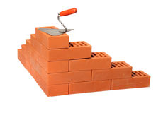 Red bricks and trowel Royalty Free Stock Photos