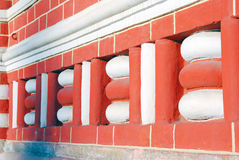 Red bricks wall decorated by white details. Stock Images