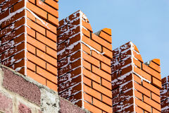 Red bricks in the wall of the Kremlin against the blue sky stock photos