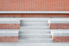 Red bricks wall with stone stairway and steps, nobody Royalty Free Stock Image
