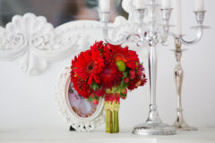 Red bridal bouquet. Red bouquet of daisies in a beautiful interior Stock Image