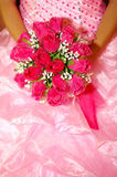 A red bridal bouquet in  the hands Stock Images