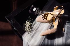 Red bride`s shoes are her perfume and veil. As well as jewelry for her hair Royalty Free Stock Image