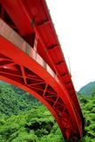 Red bridge. In the mountain is very eye-caching Stock Photography