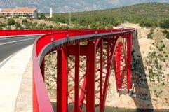 Red bridge. Long red bridge leading somewhere Stock Photo
