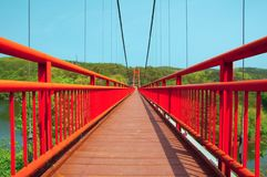 Red bridge. In the forest Stock Photography