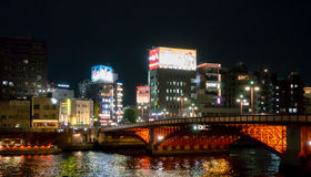 The red bridge across Sumida river to Asakusa area. Royalty Free Stock Images