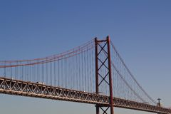Bridge against blue sky and King Christ in the background Royalty Free Stock Photos